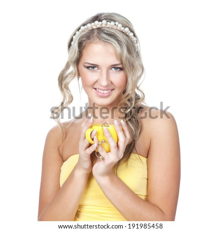 Beautiful young blonde woman in yellow dress holding yellow cup over white background