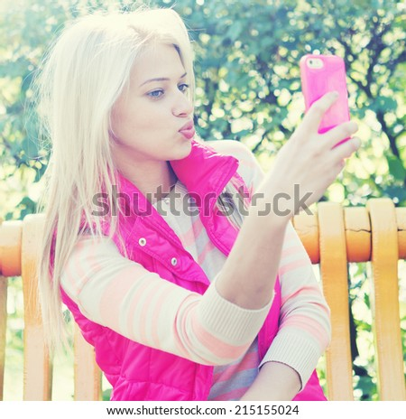 beautiful young blonde woman selfie outdoor