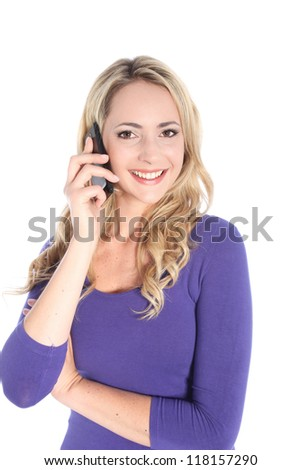 Beautiful young blonde woman talking on a cell phone isolated on white - stock photo
