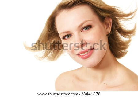 beautiful young blonde woman with flying hair