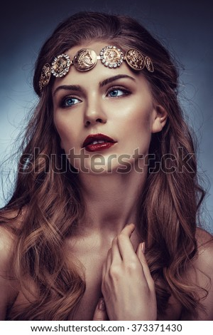 Beautiful young blonde woman with long hair with a diadem in the Greek style. - stock photo