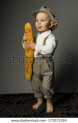 beautiful young boy with french costume and baguette - stock photo