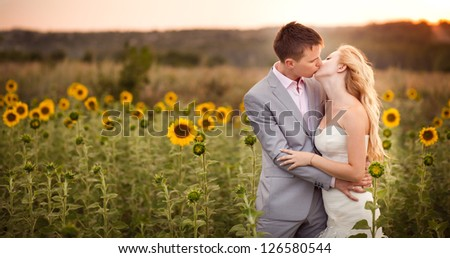 Beautiful young bride, in the wedding day with her beautiful groom - stock photo