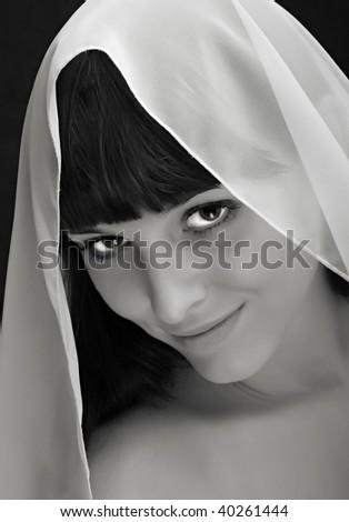 Beautiful young bride portrait in bridal veil. Monochrome studio shot. Great for calendar. - stock photo