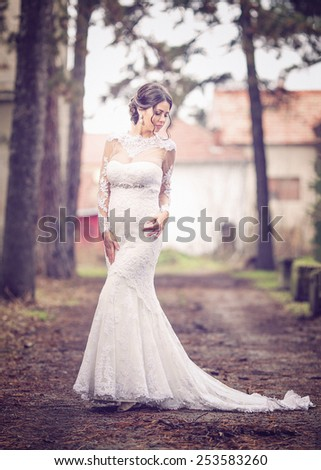 Beautiful young bride posing in summer. Wedding portrait