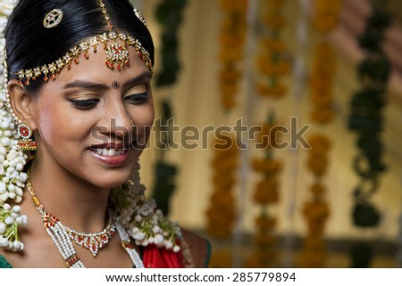 Beautiful young bride smiling - stock photo