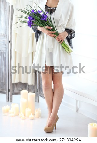 Beautiful young bride with a wedding bouquet. Last preparations for the wedding. Bride waits for her groom. Morning, the bride. Details - stock photo