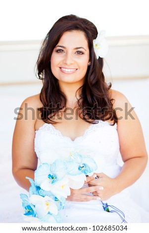 beautiful young bride with bouquet - stock photo