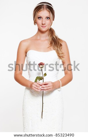 beautiful young bride with flower - stock photo