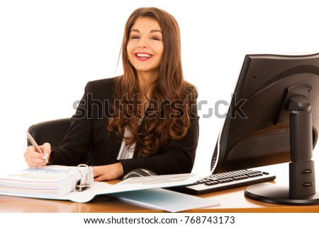 Beautiful young brunette business woman work in her office