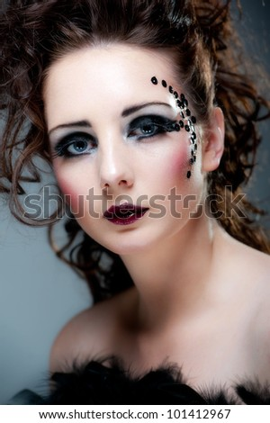 Beautiful young brunette female with beautiful makeup
