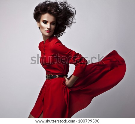 Beautiful young brunette female with bright fashion multicolored make-up. Studio photo. - stock photo
