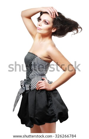 Beautiful young brunette female with bright fashion multicolored make-up. Studio photo.