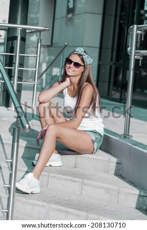beautiful young brunette girl outdoor - stock photo