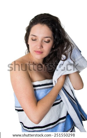 beautiful young brunette girl wrapped in towel after shower drying her hair isolated on white - stock photo