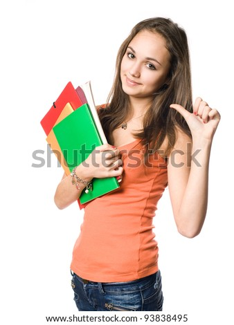 Beautiful young brunette student pointing towards herslef with thumb. - stock photo
