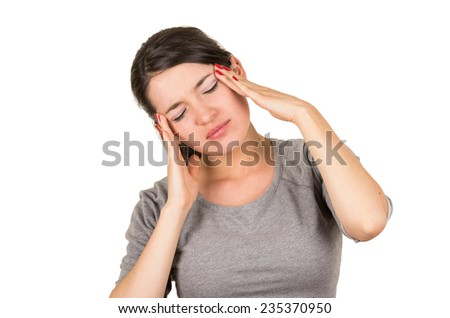 Beautiful young brunette sweet girl posing with hands on her head gesturing headache isolated on white - stock photo