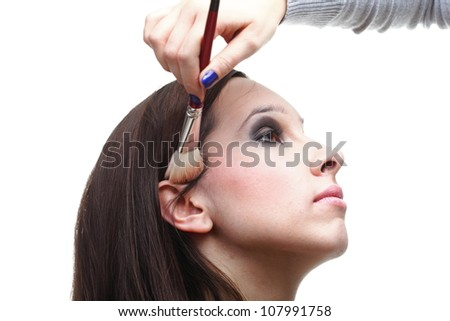 beautiful young brunette woman applying powder with a brush isolated on white - stock photo