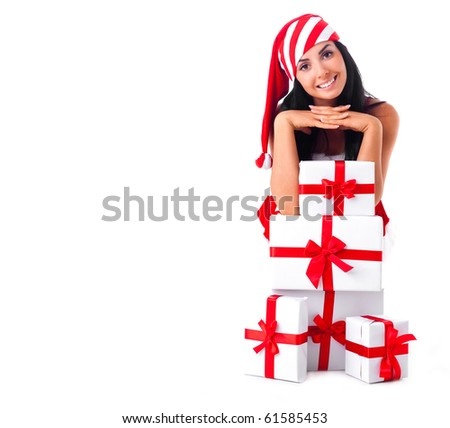 beautiful young brunette woman dressed as Santa sitting on the floor with a lot of presents