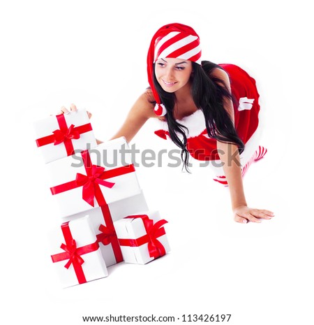 beautiful young brunette woman dressed as Santa with a lot of presents, isolated against white background