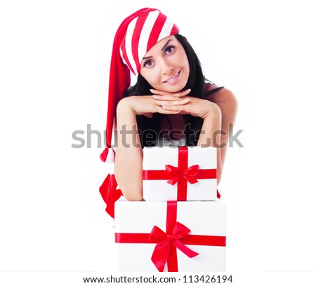 beautiful young brunette woman dressed as Santa with presents, isolated against white background