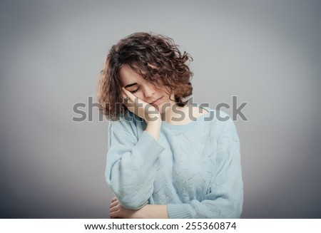 beautiful young brunette woman  gesturing sleep isolated - stock photo