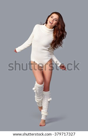 beautiful young brunette woman wearing winter clothes