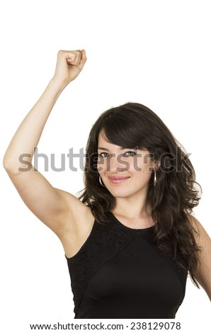 beautiful young brunette woman with black top posing holding fist up gesturing celebration isolated on white - stock photo