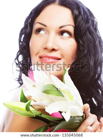 Beautiful young brunette woman with flower - stock photo