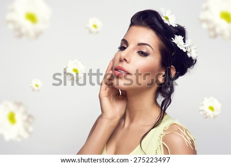 beautiful young brunette woman with flowers. Perfect face skin. Beauty Portrait. Fashion photo