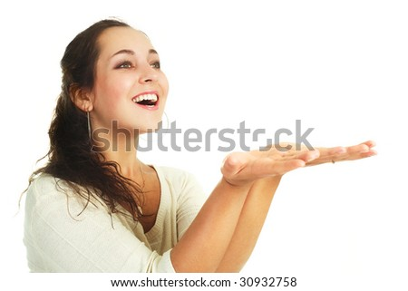 beautiful young brunette woman with her hands up, place your product here - stock photo