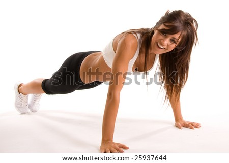 beautiful young brunette woman working out - stock photo