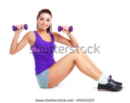 beautiful young brunette woman working out with two dumbbells - stock photo