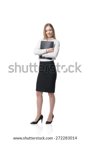 Beautiful young business lady is holding a black folder. Isolated on white background. - stock photo