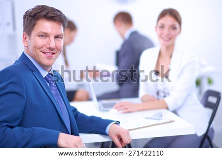 Beautiful young business people with colleagues discussing  - stock photo