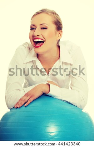 Beautiful young business with exercise ball. - stock photo