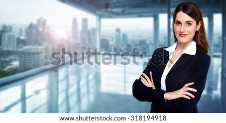 Beautiful young business woman. Accounting and finance background. - stock photo