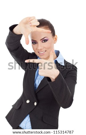 Beautiful young business woman creating a frame with her fingers and smiling through it. isolated on white.
