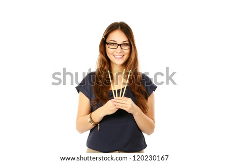 beautiful young business woman holding pencils isolated on white
