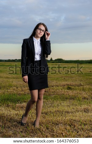 beautiful young business woman in a field