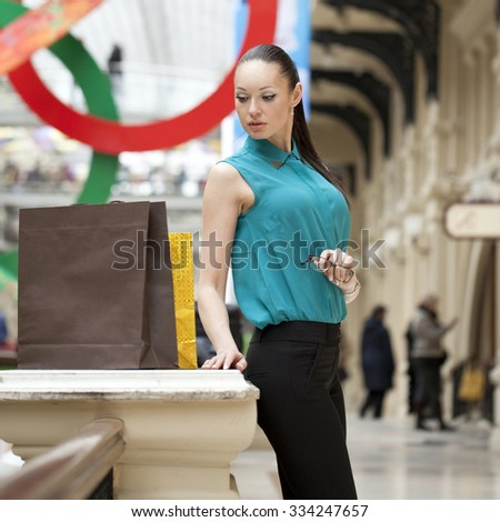 Beautiful young business woman in the store