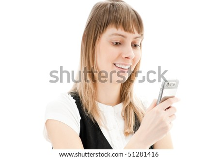 beautiful young business woman isolated on white reading new message on her cellphone