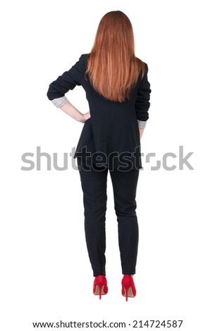 Beautiful young business woman looking at wall.Rear view. Isolated over white.