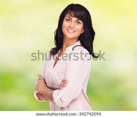 Beautiful young business woman over green background.