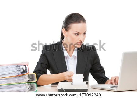 beautiful young business woman typing. pretty lady working with computer and calculating - stock photo