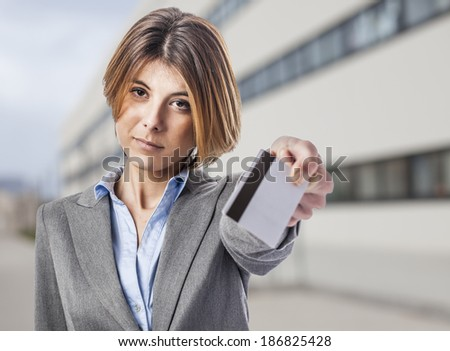 beautiful young business woman using a credit card