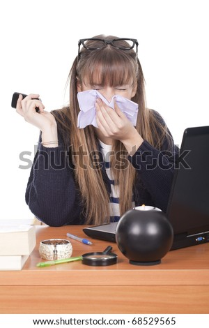 Beautiful young business woman with a cold blowing nose