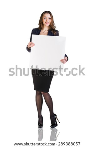 Beautiful young business woman with blank board. Full length studio shot isolated on white.