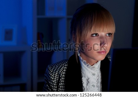 beautiful young business woman working at night in the office - stock photo