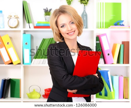 Beautiful young business woman working in office - stock photo